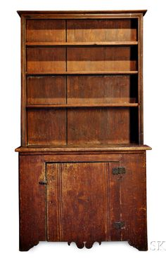 Skinner's - The Personal Collection of Lewis Scranton, Auction 2897M. May 21, 2016. Lot: 239.  Estimate: $6,000-8,000.  Realized: $19,000.   Description:  Red-painted Cant-back Cupboard, New England, late 18th century, the three molded shelves framed by molding on projecting base with a molded hinged and scroll-carved door, ht. 77, wd. 42, dp. 18 in. Wear, old replaced hinges, right half of top molding restored, old surface.   Provenance: Ron & Penny Dionne, 1981.