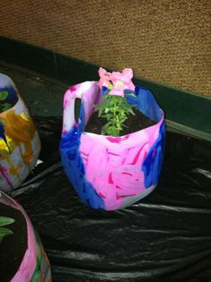 Earth Day Project - Old milk jugs made into flower pots.