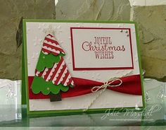Stampin' Up! ... handmade Christmas card from Stamping Impressions ... tree folded from one half of a scalloped circle ... luv the two-sided patterned paper ... red, white and green ... like the tied up wide ribbon band ...