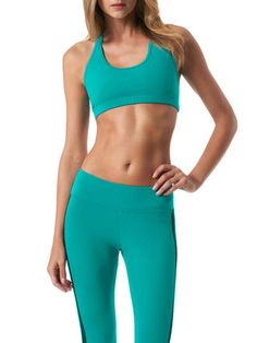 Koral Activewear. Turquoise sports bra and leggings.