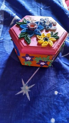 Wooden box decorated with paper quilling