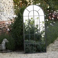 This impressive large arched outdoor mirror is sure to brighten any garden space to stunning effect.The black metal frame, lightly distressed in gold leaf, and striking window design provide just the right amount of detail to make this generously sized mirror really stand out. With beautiful reflective qualities to create a sense of space to any sized garden, simply hang or prop against a wall to create a gorgeous outdoor feature. This mirror is frost protected to withstand any weather.Metal ... Outdoor Mirrors Garden, Garden Mirrors, Mirrors In Gardens, Outdoor Art, Outdoor Rooms, Outdoor Living, Outdoor Decor, Small Courtyard Gardens, Small Courtyards