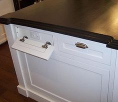 Kitchen Island Have Electrical Outlets Hidden Behind Fake Drawers When Not