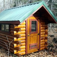 log cabin mobile homes.  Reminds me of the tiny cabin my grandparents built on their mountain property to live in while they were building the larger cabin.  Their full-size mattress and box springs took up almost one whole side end-to-end, while the other side contained a small table, chairs and a pot-belly stove.