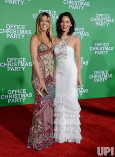 Jennifer Aniston and Olivia Munn, who star in the holiday comedy {i:Office Christmas Party}, shared some laughs on the red carpet at the film's L.A. premiere. Katy Perry, Molly Sims, and Jimmy Kimmel also attended.