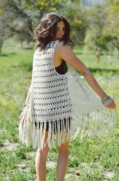 Spring Knit Vest in Patterned Crochet with Open Front and Fringed Hemline.Measurement Approximately 35 inches from Shoulder to Hem, 8 inches of Fringe.Sleeveless, Vest, Open, Knit, Knitted, Crochet, Fring, Fringed, Spring, Lightweight.