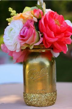 Mason jar flower arrangement......Love the gold and glitter!