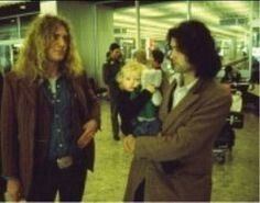 Jimmy holding Scarlet at the airport, 1978