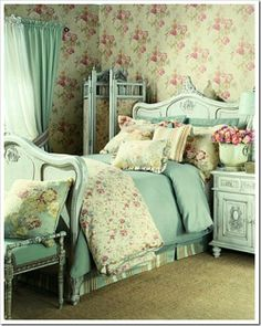 I love this room, especially the aqua soft bed linens & furniture