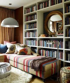 Like the idea of low arm sofa next to bookcase ... Perfect for reading...mount swing arm lamp to side of bookcase