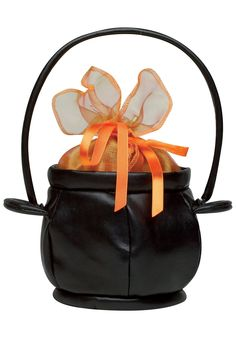 This witch purse is shaped like a classic cauldron, and has a black, leather-like exterior with a short handle for easy carrying.