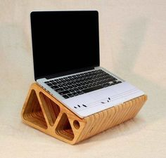 """Raises your laptop screen up 7"""", allowing for a more comfortable experience. No more neck cramps! The open middle allows for airflow, which keeps your machine cool."""