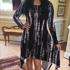 Tie Die Asymmetrical Dress Asymmetrical black and white tie die dress  Lightweight | Long sleeve | relaxed fit  NO TRADES striped    96% polyester  4% Lycra Classic Woman Dresses Asymmetrical