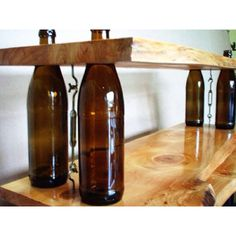 """Bottle shelves- crafty idea for a home bar.. Great for a """"man cave"""" even though I think they are lame... why don't women get caves? oh yea because we get the rest of the house ;-)"""