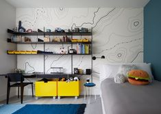 """The parents of a five-year-old boy feared that his room would read """"too young"""" when he grew up, so Tang infused the space with elements that would balance fun and flexibility. A graphic topological map from HappyWall and yellow color blocking add youthfulness while Vitsoe modular shelving and custom bins on casters ensure that the room can be adjusted. #dwell #howtodesignakidsroom #kidsroom #moderndesign #howto #diy #designtips Home Interior, Interior Architecture, Interior Design, Living Room Designs, Living Spaces, Kid Spaces, Modular Shelving, Commercial Interiors, Design Firms"""