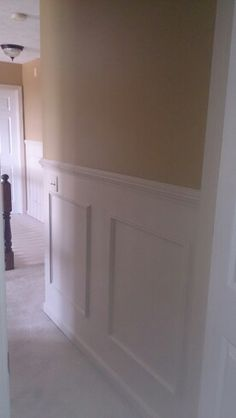 Add inexpensive chair rail And trim boxes, paint an off white..... Easy upgrades to add value to your home