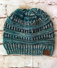 ** New Confetti knits just added!! ** Super soft women's knit beanie hats by CC. Available in many fabulous colors - the perfect cold weather accessory! 100% Acrylic, one size fits most. Also availabl