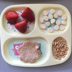 Today's breakfast for princess A. Three strawberries, mozzarella cheese, whole wheat bread wi...