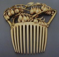 Hair holders were turned into adornment items, such as this  comb hair holder. Even hat pins had designs. Art Nouveau Jewelry Images - Google Search: www.tademagallery.com 400 × 311 Search by image The Paris Salons 1895-1914, Jewellery, Volume I: The Designers A-K, Alastair Duncan 1994, p.41  42. Art Nouveau Jewelry, Vivienne Becker, 1985, p. 214.