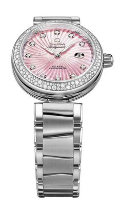 """Like their predecessors, the new LadyMatics are powered by Omega's automatic Caliber 8520, developed specifically for the brand's ladies' models, which has been COSC-certified as a chronometer. The stainless steel cases are 34 mm in diameter with white, black or rose-colored ceramic elements, offered on either a satin-brushed leather strap or polished steel bracelet. The dials have a decorative """"SuperNova"""" pattern and are adorned with 11 diamond-set indices set into faceted white-gold…"""
