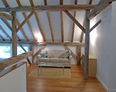 Despite its contemporary exterior, this 1800s converted barn retains its hand-hewn beams and half-round rafters. The Copake home has an open plan, with the living area featuring a staircase to the loft, and a large fireplace. The entire space has impeccably maintained hardwood floors, and includes four bedrooms and three bathrooms. The large deck and covered porch make the ideal perch to enjoy mountain views and the three acres of lush lands