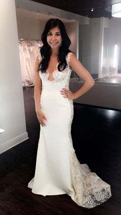 Plunging neckline, lace wedding dress from Solutions Bridal.    Ines Di Santo wedding dresses