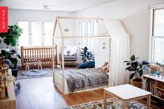 Amazing nursery- one of the best shared kids rooms I've ever seen!! Natural, organic, patterns, restrained feel but definitely still for the kids. House shaped bed, low Montessori style furniture, muted colours, lots of bright light.