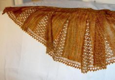 A simple design to show off a magic yarn (it seems to beckon John Bauer's fairies and princesses).The shape and construction imitate my Ifigenia, but unlike the more intricate Ifigenia, this is truly straightforward and simple.simple pattern (written and with illustrative charts)knit in 6 wedges + 1/2 another wedgepicot cast-on & bind-off (optional)short rows - each wedge gets smaller for each two rows, which means the knitting speeds up as you gothe lace mesh is a 4-stitch repea...