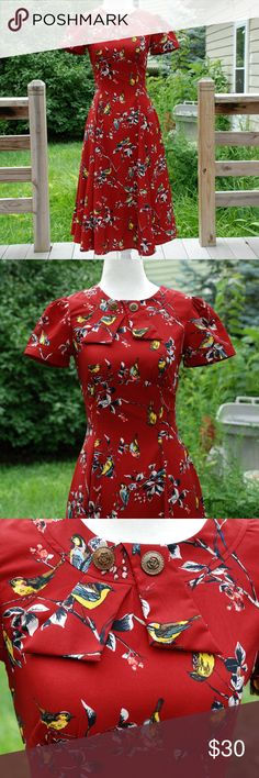 """Hell Bunny Birdy Wartime Landgirl Tea Dress Beautiful 1940s-inspired tea dress by Hell Bunny! Dark red/burgundy with a lovely birdy pattern. Zip-up back. I also have an extra button for the collar that I will send along.   Measurements:  Bust: 32"""" Waist: 26"""" Hell Bunny Dresses Midi"""