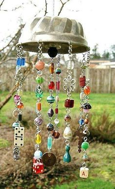 The cake pan will never do. Must use something else.  :)  Wind chime - a colander would work better.  You could hang the wires from the inside.