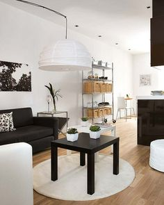 40 Inspiring small space interiors  I like the Lack tables in black and white on a circle rug.