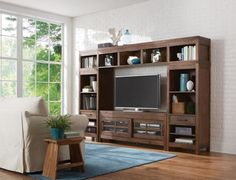 "The St. Croix 64"" Wall Unit features two front sliding doors with industrial hardware, multiple shelving options, and mortison and tenon corner joint construction."