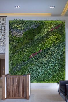 Commercial Design : Luxury Airport Lounge by SHH... Loooove this living wall!