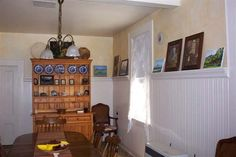 Country Rooms with Beadboard | The dining room features beadboard paneling and an eclectic art ...