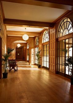 Beautiful Limed Oak paneling, art deco windows and ball chandeliers in the gallery at Coombe Lodge taken by Nick Wilcox-Brown