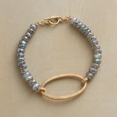 "MODERN KEEPSAKE BRACELET -- Using an age-old wire-wrapping technique, Dana Kellin creates this deftly refined, keepsake-worthy pearl and labradorite bracelet. The design combines labradorite?s shimmering elegance with luminous pearls and 14kt gold-filled wires. USA. 7-1/4""L."