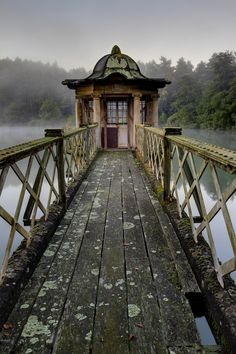 Abandoned pump house & conservatory in a lake, Witley Park, Surrey, UK.