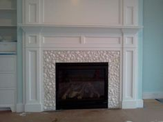fireplace surround with shells.... so want to do this one day!!!!