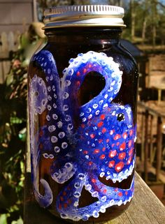 Blue Octopus on a Brown Upcycled Jar For Storage or Window Decoration. $25.00, via Etsy.