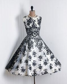 1950's Vintage Ethereal Ivory-White and Black Floral-Flocked Sheer Nylon-Chiffon Elegant Scoopneck Sleeveless Wide Cummberbund Belted Nipped-Waist Cocktail-length Rockabilly Ballerina-Cupcake Princess Full Circle-Skirt Bombshell