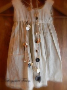 crocheted string necklace with vintage and antique buttons.