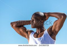 Standing African Black Man Wearing White Vest And Blue Short Jeans. Male Model Thinking While Isolated Alone By A Blue Ocean And Sky Background. Cape Town South Africa Stock Photo 245368729 : Shutterstock http://www.shutterstock.com/pic.mhtml?id=245368729