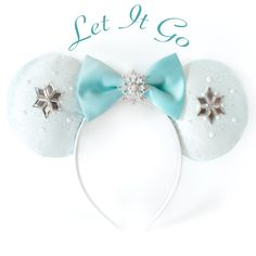 These Elsa ears have a center snowflake made of Grade A+ clear rhinestones and silver plated metal, clear diamond shaped rhinestones, high quality white satin, green glitter tulle, and a white satin h