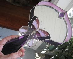 It is made from pink and purple real stained glass. A hand mirror with a stained glass butterfly in the center. It has an Art deco appeal to it. Stained Glass Mirror, Stained Glass Projects, Glass Mirrors, Glass Butterfly, Purple Butterfly, Beautiful Butterflies, Art Deco, The Incredibles, Dragonflies