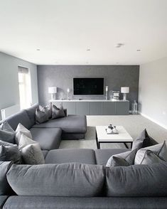 Dark colours make spacious areas look much cozier and homeowner Natalie & Craig . - Dark colours make spacious areas look much cozier and homeowner Natalie & Craig ( have chosen grey as… Living Room Sofa Design, Home Room Design, Living Room Grey, Home Living Room, Living Room Designs, Living Room Decor, Dining Room, Lounge Design, Elegant Living Room