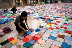 Oxfams giant knitted petition - On 18 September 2008, campaigners and volunteers from Oxfam handed in a giant, knitted petition to the UK government. This photo shows the blanket being assembled before the hand in. More than 15,000 individual squares were made by Oxfam supporters from throughout the UK.