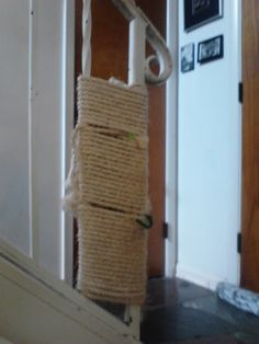 homemade scratching post- just use a rough and somewhat thick rope (natural fiber- i believe this is sisal), and anchor it to the banister with pipecleaners. at first i also tied a catnip mouse to the railing to encourge the cats to use it, but now it's become habit and they use it daily :)
