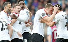 Manchester United players congratulate each other after scoring against Villa