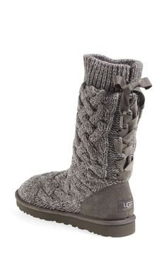 Love the super cute bow detail on the back of these adorable knit Ugg boots.
