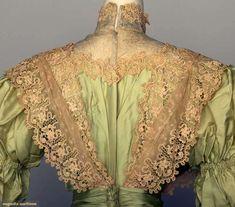 GREEN SILK TEA DRESS, c. 1898 2-piece mint green China silk, chemical lace flounce trim on bodice & skirt, silk chiffon waist, black velvet ribbon, white eyelet & diamante button trims. Detail